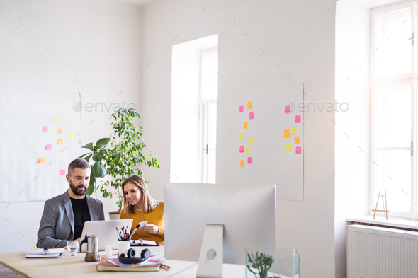 Two business people with laptop in the office. - Stock Photo - Images