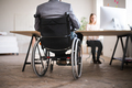 Two business people with wheelchair in the office. - PhotoDune Item for Sale