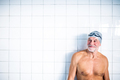 Portrait of a senior man in an indoor swimming pool. - PhotoDune Item for Sale