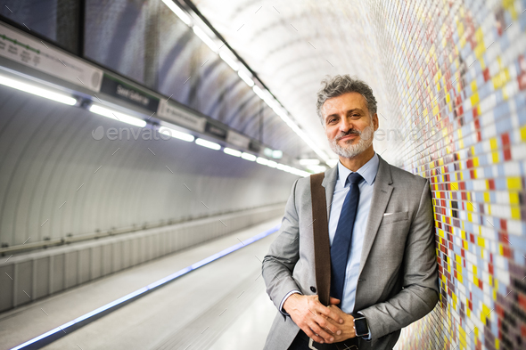 Mature businessman waiting on a metro station. - Stock Photo - Images