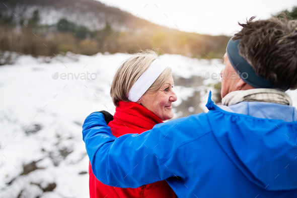 Senior couple jogging in winter nature. - Stock Photo - Images