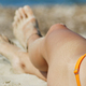 Female legs and feet on white sandy beach. Summer vacation concept - PhotoDune Item for Sale