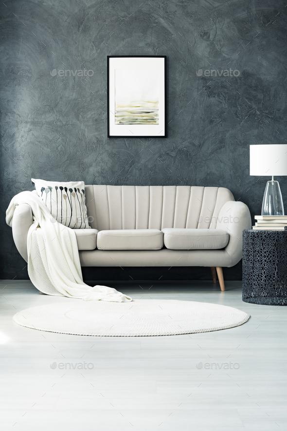 Sofa by dark grey wall - Stock Photo - Images