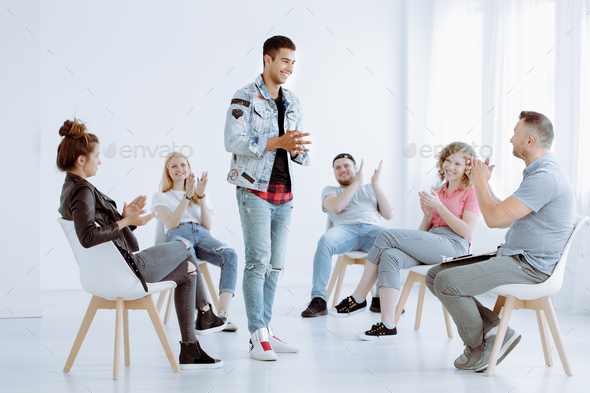 Young people clapping after performance - Stock Photo - Images