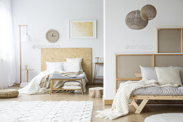 Natural bedroom with wooden bedhead - Stock Photo - Images