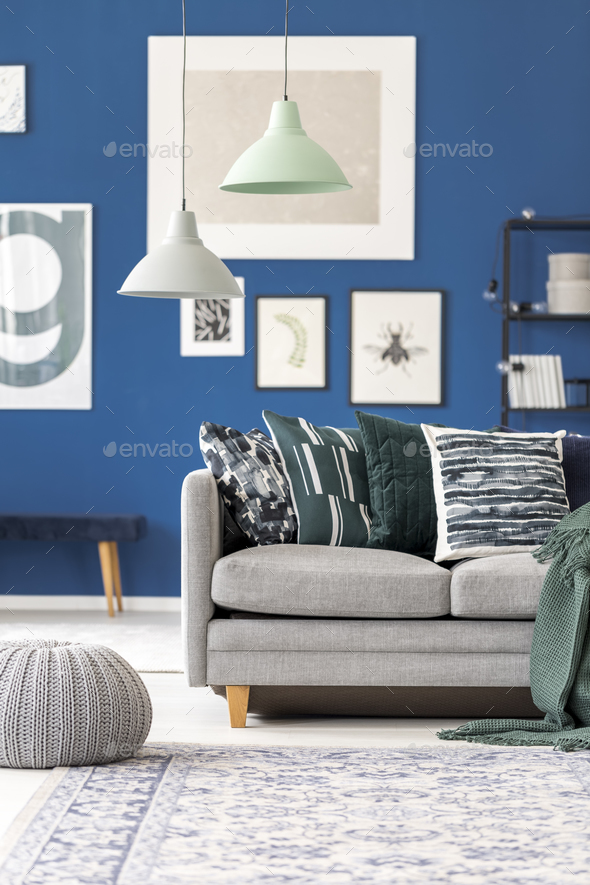 Pastel lamps above grey couch - Stock Photo - Images