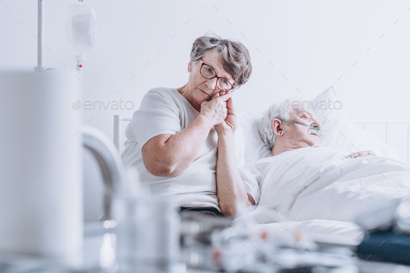 Loving wife at hospital bed - Stock Photo - Images