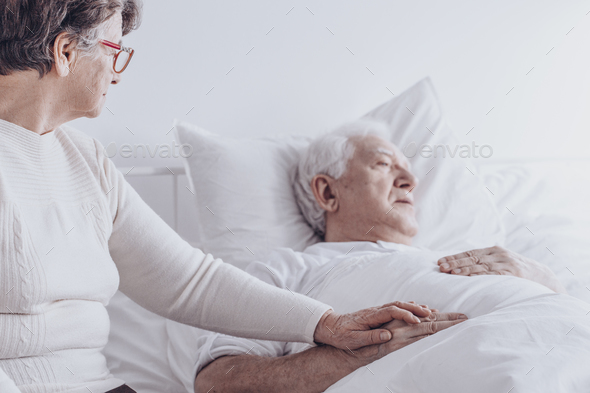 Elderly woman visiting sick husband - Stock Photo - Images