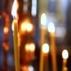 Burning Candle Out of Focus in the Altar in the Christian Church - VideoHive Item for Sale