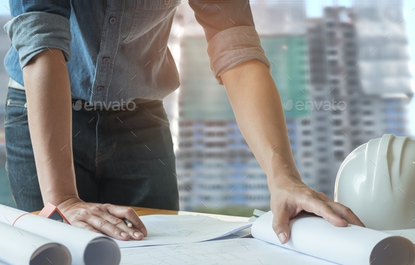 Architects have pencils in hand, are writing home plans with con - Stock Photo - Images