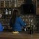 Joyful Women Chatting Over Red Wine in the Kitchen