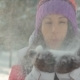 Happy Pretty Young Woman Blowing Snowflakes From Her Hands in a Winter Day - VideoHive Item for Sale