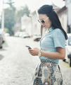 Fashionable woman texting on the street - PhotoDune Item for Sale