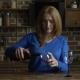 Woman Pouring Red Wine Into Glasses in the Kitchen - VideoHive Item for Sale