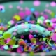 Glitter Exploding Into a Rainbow of Colors Speaker Part. Music Loop Background. - VideoHive Item for Sale