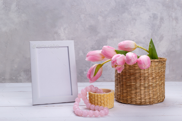 Empty picture frame and tulips - Stock Photo - Images
