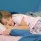 Cute Little Girl Trying To Sleep in Her Crib and Smiling - VideoHive Item for Sale