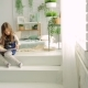 Two Little Girls in a Bright Room with Plants, Read a Book - VideoHive Item for Sale