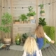 Two Girls Playing in the Room Decorated with Green Plants Two Girls Sisters Having Fun - VideoHive Item for Sale