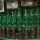 The Green Plastic Bottles On The Conveyor Pouring Of Drinking Water - VideoHive Item for Sale