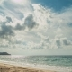 Beach and Mountains Behind. From the Clouds Make Their Way Rays of the Sun - VideoHive Item for Sale
