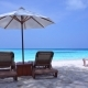 White Sun Umbrellas and Beds at Seaside - VideoHive Item for Sale