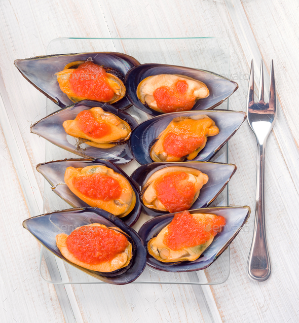 Aerial making Galician mussels in glass tray - Stock Photo - Images