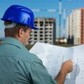 engineer reading construction plan - PhotoDune Item for Sale