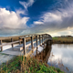 wooden bridge via river and blue sky - PhotoDune Item for Sale
