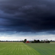 dark stormy sky over summer farmland - PhotoDune Item for Sale