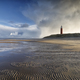stormy sky over North sea beech and lighthouse - PhotoDune Item for Sale