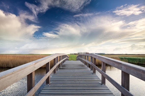 wooden bridge via river and blue sky - Stock Photo - Images
