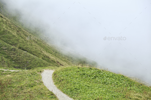 path in mountains into fog - Stock Photo - Images