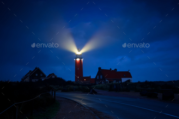 lighthouse lightbeams in night - Stock Photo - Images
