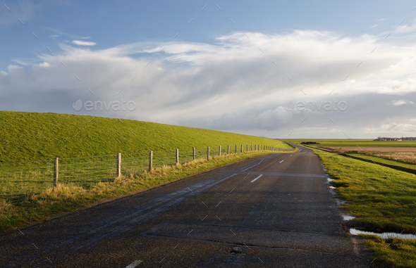 road between green hills and blue sky - Stock Photo - Images