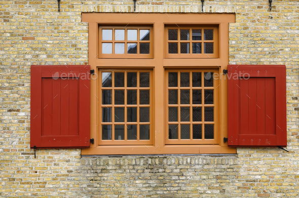 old red wooden window on brock wall - Stock Photo - Images