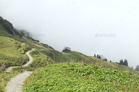 path to cabin in fog in mountains - Stock Photo - Images