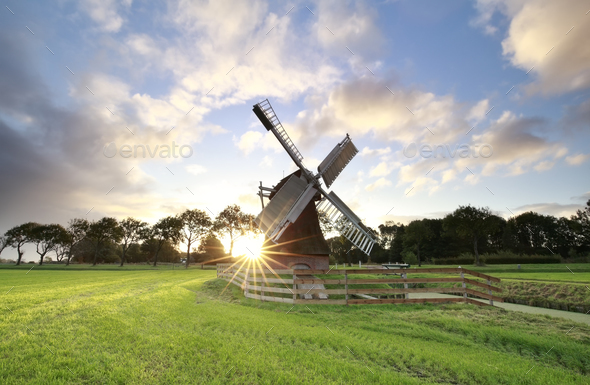 beautiful sunrise behind Dutch windmill - Stock Photo - Images