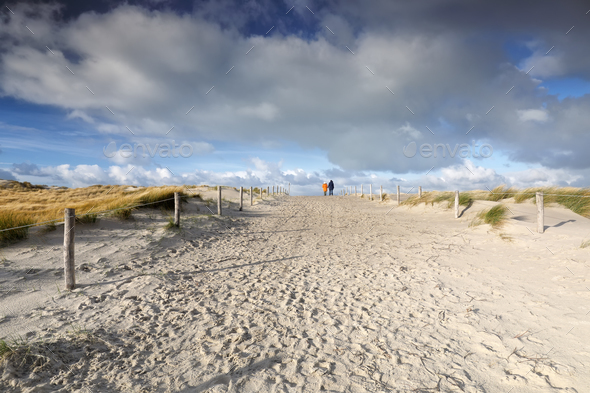 people walk on sand path and blue sky - Stock Photo - Images