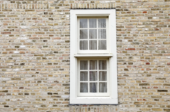 white wooden window on brick wall - Stock Photo - Images