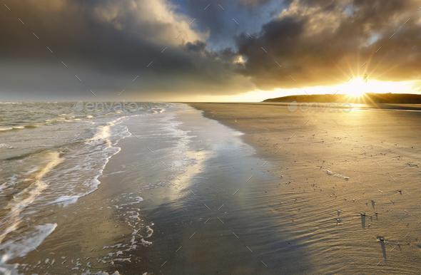 gold sunrise over North sea coast - Stock Photo - Images