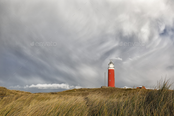 dramatic sky over ed lighthouse on hill - Stock Photo - Images
