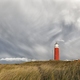 dramatic sky over ed lighthouse on hill - PhotoDune Item for Sale