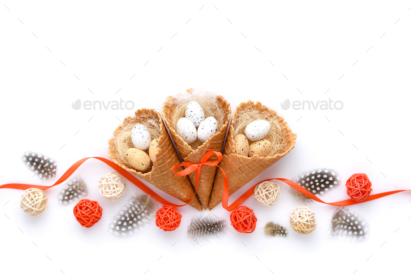 Easter festive background with waffle cones with small eggs on w - Stock Photo - Images