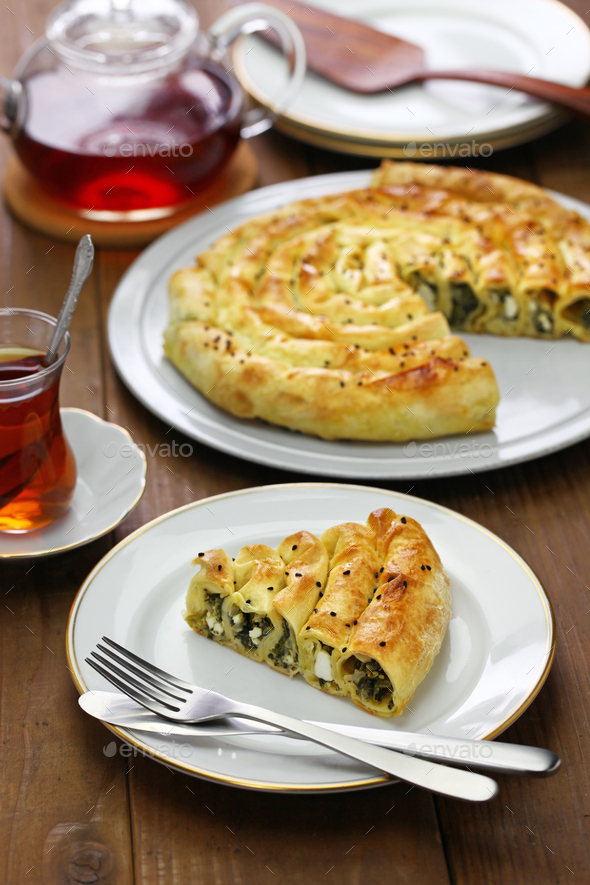 homemade kol borek, turkish rounded pie, spinach and feta cheese - Stock Photo - Images
