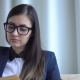 Young Attractive Business Woman in Office Suit Reads a Book Near the Window. - VideoHive Item for Sale