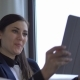 Young Attractive Woman Calls Her Family Via Tablet and Skype From Work. - VideoHive Item for Sale
