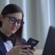 Young Attractive Woman in the Suite Sit with Laptop and Texting. - VideoHive Item for Sale