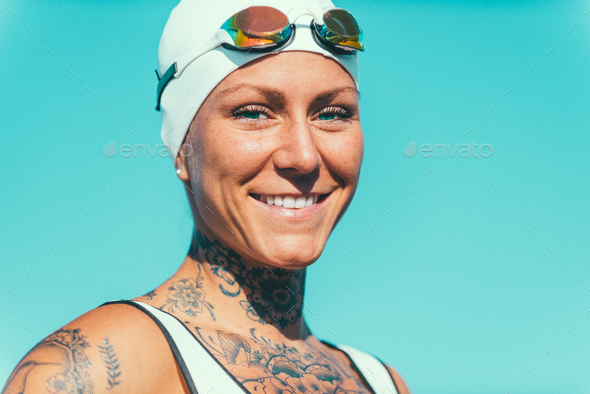 Portrait of female swimmer with tattoos - Stock Photo - Images