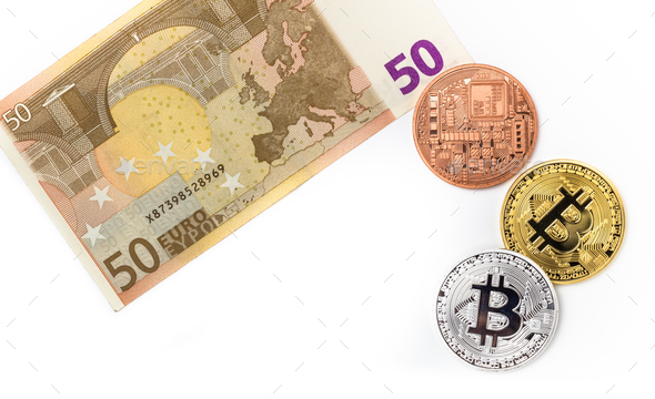 Image of bitcoins on euro bill - Stock Photo - Images